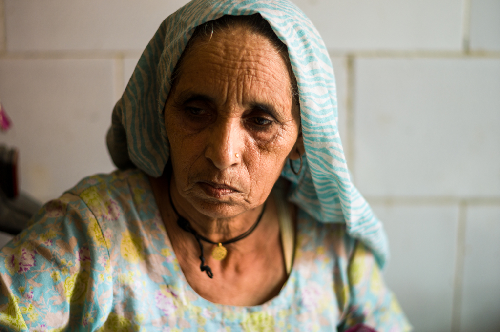 Ilmo, Geetha's mother. Partially paralysed and can no longer work. Depends on Geetha to support her. Her sons don't contribute to helping her or Geetha.